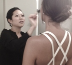 Hitomi gives Kandrie a touch up before shooting