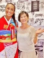Masako Formals store owner Kumi (right) stays stoked.